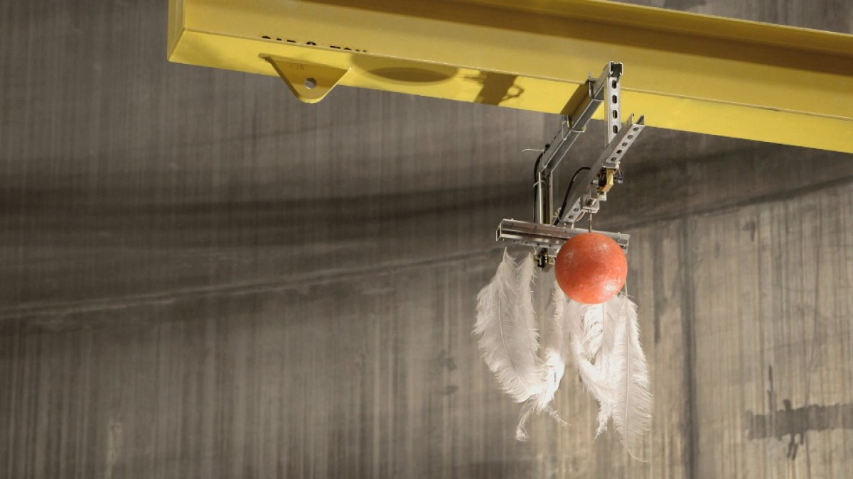 A Feather and a Bowling Ball Dropped Together Inside the World's Largest Vacuum Chamber