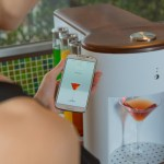 Somabar, A Compact Robotic Bartender That Precisely Mixes Cocktails in Conjunction With a Smartphone App