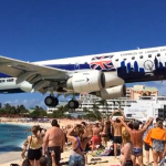 Slow-Motion Video of a Low-Flying Commercial Airliner Landing Mere Feet Away From a Crowded Beach