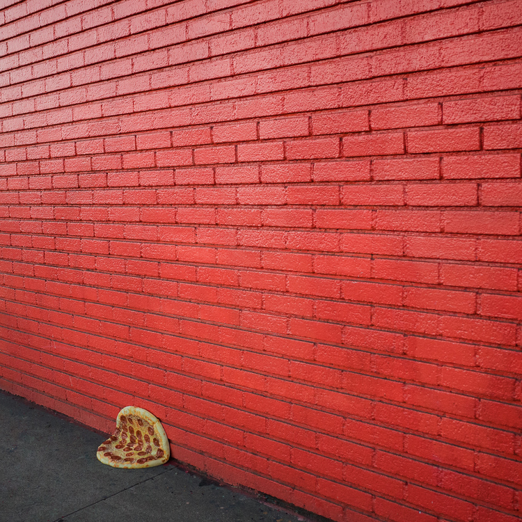 pizza and red wall