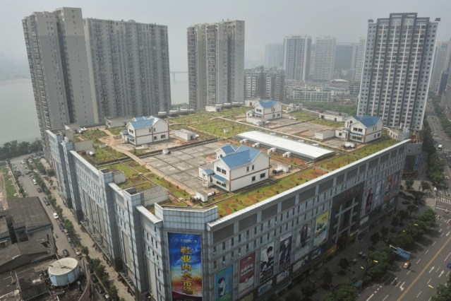 Four houses on roof of Chinese mall