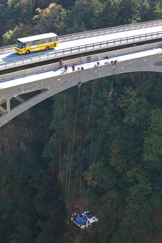 Hot tub suspended from bridge