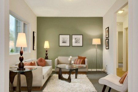 living room with green accent wall color | trend home