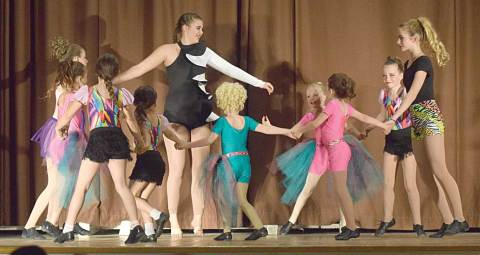 "Dancers spin in a circle during ""Flower,"" the opening performance at the Craik School of Dance recital on May 7."