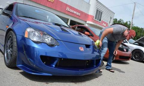Moose Jaw resident Brennen Duncan gives a quick clean to his customized 2003 Acura RSX Type S.
