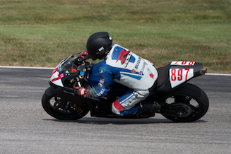 My husband during one of his first novice races at New Hampshire Motor Speedway. ©2012 Kristin M Woodman.