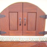 """Spanish featuring custom IPE doors made by Leasure Concepts."""