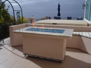 """""""This fire pit featured a custom fire ring built by Leasure Concepts.com and fire glass by Fire Crystals.com."""""""