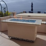 """This fire pit featured a custom fire ring built by Leasure Concepts.com and fire glass by Fire Crystals.com."""