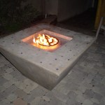 """Outdoor fire pit before it was painted white."""
