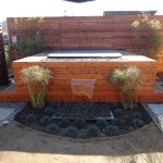 Custom outdoor water feature, & fire pit reset into spa area.