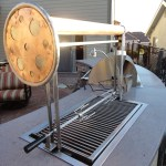"""Constructed out of Stainless Steel & Copper. Both the Rottisserie and Grill Grates are removable which lift and lower with a turn of the wheel. A 3"""" copper tube connects the two grill supports."""