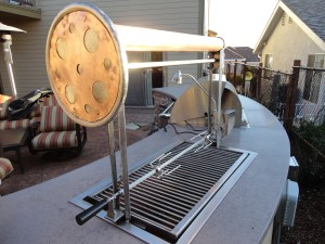 "Constructed out of Stainless Steel & Copper. Both the Rottisserie and Grill Grates are removable which lift and lower with a turn of the wheel. A 3"" copper tube connects the two grill supports."