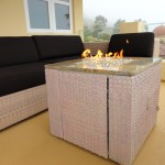 This fire pit was designed to match the DEDON outdoor wicker furniture. It turned out great!