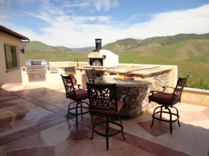 Tuscan themed outdoor kitchen with water featrure fire pit, Earth Stone pizza oven, and Fire Magic Appliances.