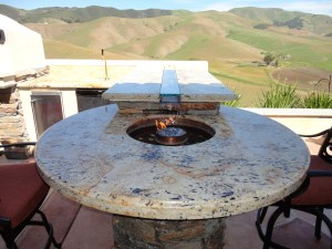 Outdoor Fire Pit Water Feature built into the bar top with LED color changing lights.