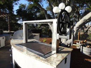 Features a stainless steel frame and grill grate. There a vintage Steam Boat Fly Wheel and gear which enables the grills functionality.