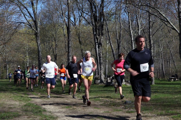 Runners exit woods at Kimberly Bridge. Nick Ohnell (yellow shorts) running in his 20th Loop.