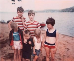 A 1967 Photo Of The Johndrow kids and the boat in back!