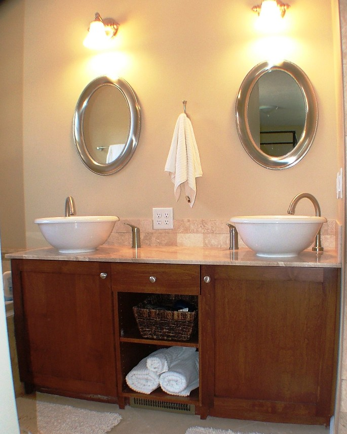 Custom bathroom vanity with open shelves in middle.