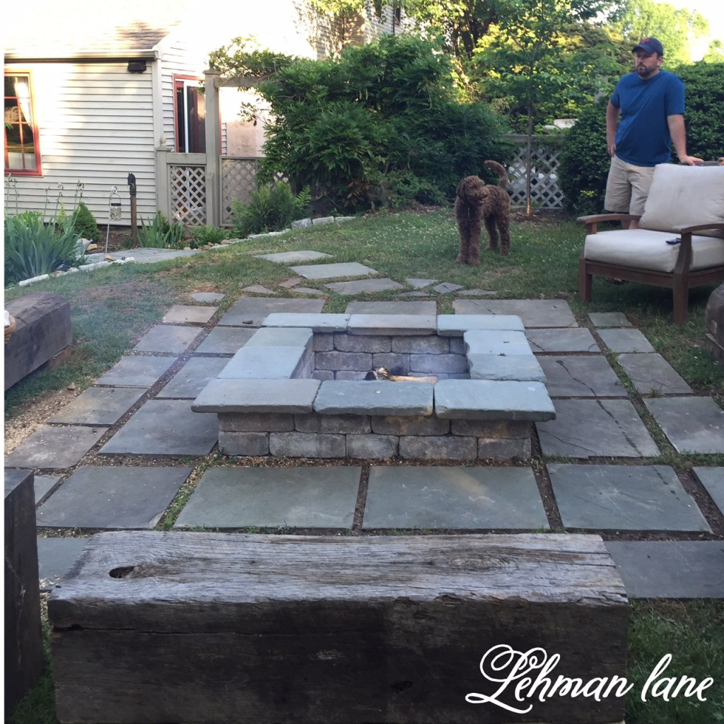 Diy stone patio fire pit wood beam benches lehman lane for Diy patio fire pit