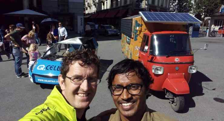 Solar powered tuk tuk stops in Switzerland on its way from India to London