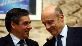 French Former Prime Minister Francois Fillon (L) speaks with Bordeaux's mayor and French right-wing UMP party for the March mayoral elections in Bordeaux Alain Juppe during a public meeting on March 6, 2014 in Eysines near Bordeaux, southwestern France.   AFP PHOTO / NICOLAS TUCAT