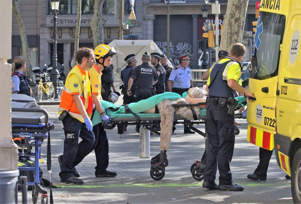 FACES PIXELATED BY SOURCE DUE TO LOCAL LAW Mandatory Credit: Photo by Quique Garcia/EPA/REX/Shutterstock (9007932l) Mossos d'Esquadra Police officers and emergency service workers move an injured after a van crashes into pedestrians in Las Ramblas, downtown Barcelona, Spain, 17 August 2017. According to initial reports a van crashed into a crowd in Barcelona's famous Placa Catalunya square at Las Ramblas area injuring several. Local media report the van driver ran away, metro and train stations were closed. The number of people injured and the reasons behind the incident are not yet known. Official sources have not confirmed that the incident is a terrorist attack. A van crashes into pedestrians in Barcelona, Spain - 17 Aug 2017