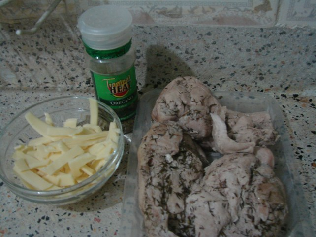 cheese shreds, oregano leaves, poached chicken breasts