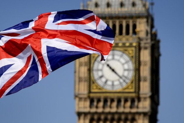 """A British flag floats in front of the """"Big Ben"""" clock Tower on July 23, 2012 in London, four days before the start of the London 2012 Olympic Games. Seven years in the making, costing £9.3 billion ($14.5 billion) and featuring 10,490 athletes, the London Olympics opens on July 27 with 302 gold medals to be won and hard-fought reputations at stake.    AFP PHOTO / FABRICE COFFRINI"""