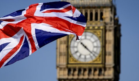 "A British flag floats in front of the ""Big Ben"" clock Tower on July 23, 2012 in London, four days before the start of the London 2012 Olympic Games. Seven years in the making, costing £9.3 billion ($14.5 billion) and featuring 10,490 athletes, the London Olympics opens on July 27 with 302 gold medals to be won and hard-fought reputations at stake.    AFP PHOTO / FABRICE COFFRINI"