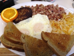 My breakfast at leaning tree - eggs, sausage, hash, potatoes and toast - YUM