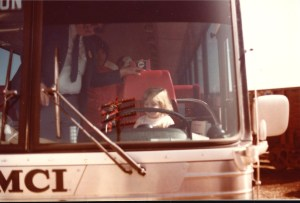 Little Amaree, then 2 1/2, tries to drive the big charter bus in Flagstaff, AZ (Oct 1982)
