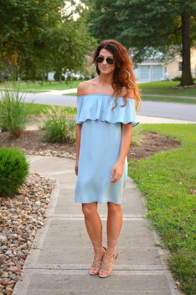 ashley from lsr in a blue ruffled chambray dress, lace up sandals