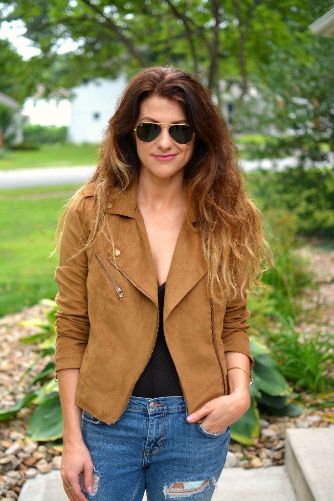 ashley from lsr in a faux suede jacket and a sheer bodysuit
