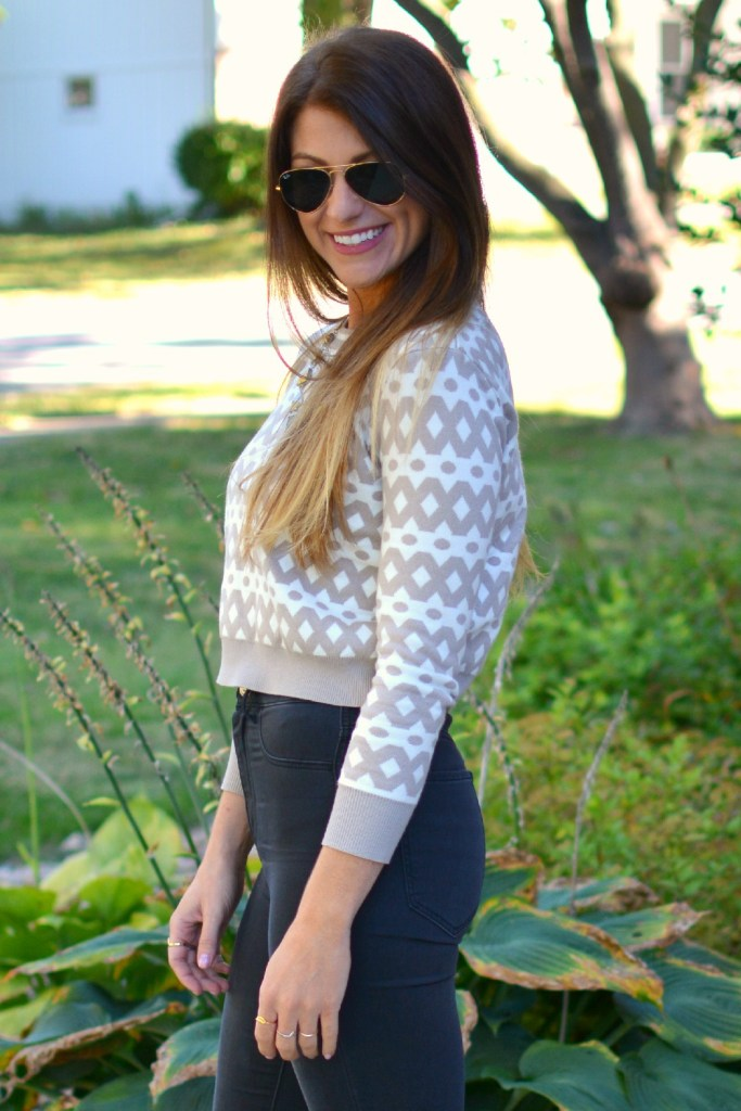 Ashley from LSR in high-waisted black H&M jeggings and a cropped printed sweater.