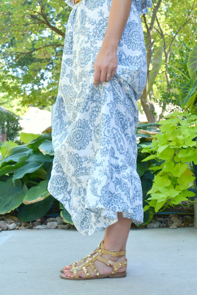 Ashley from LSR in a printed linen maxi dress and studded sandals