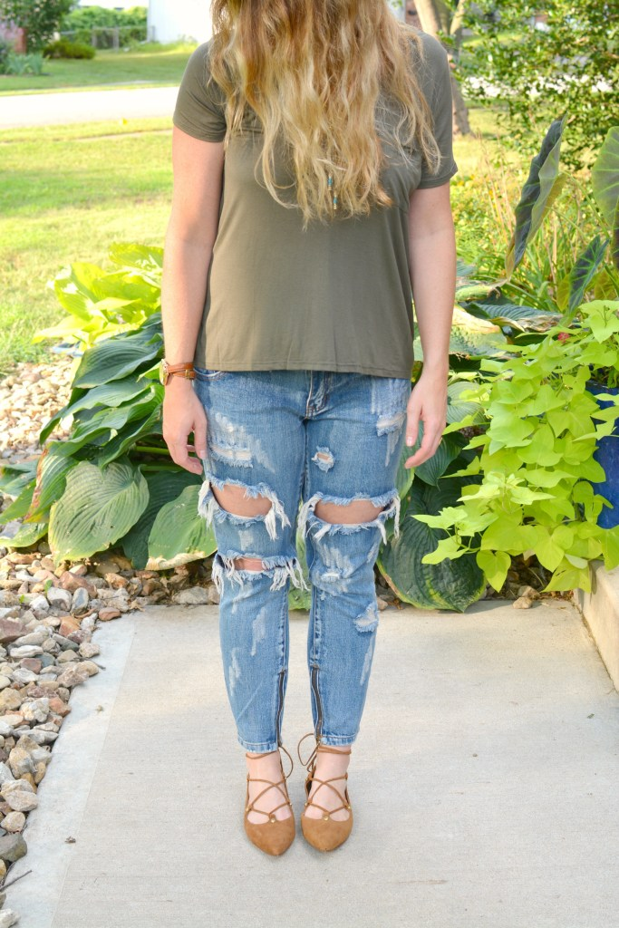 Ashley from LSR in an olive green tee and One Teaspoon jeans