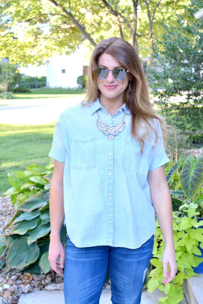 Ashley from LSR in a light chambray shirt and a statement necklace