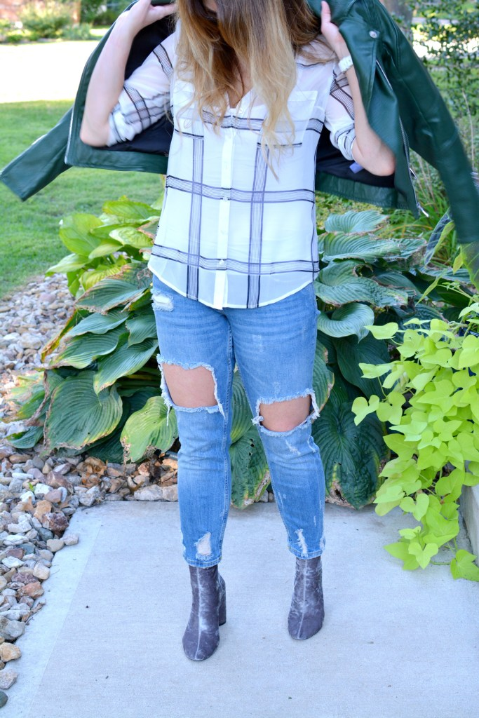 Ashley from LSR in a green leather jacket, destroyed denim, and velvet booties