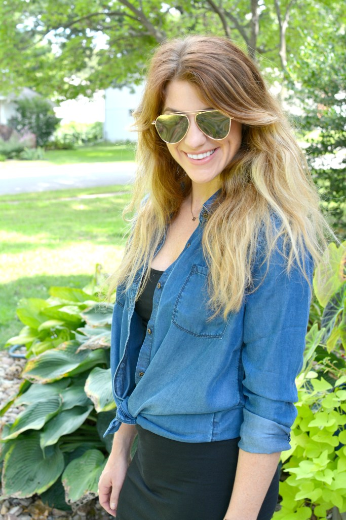 Ashley from LSR in a black t-shirt dress and a chambray shirt