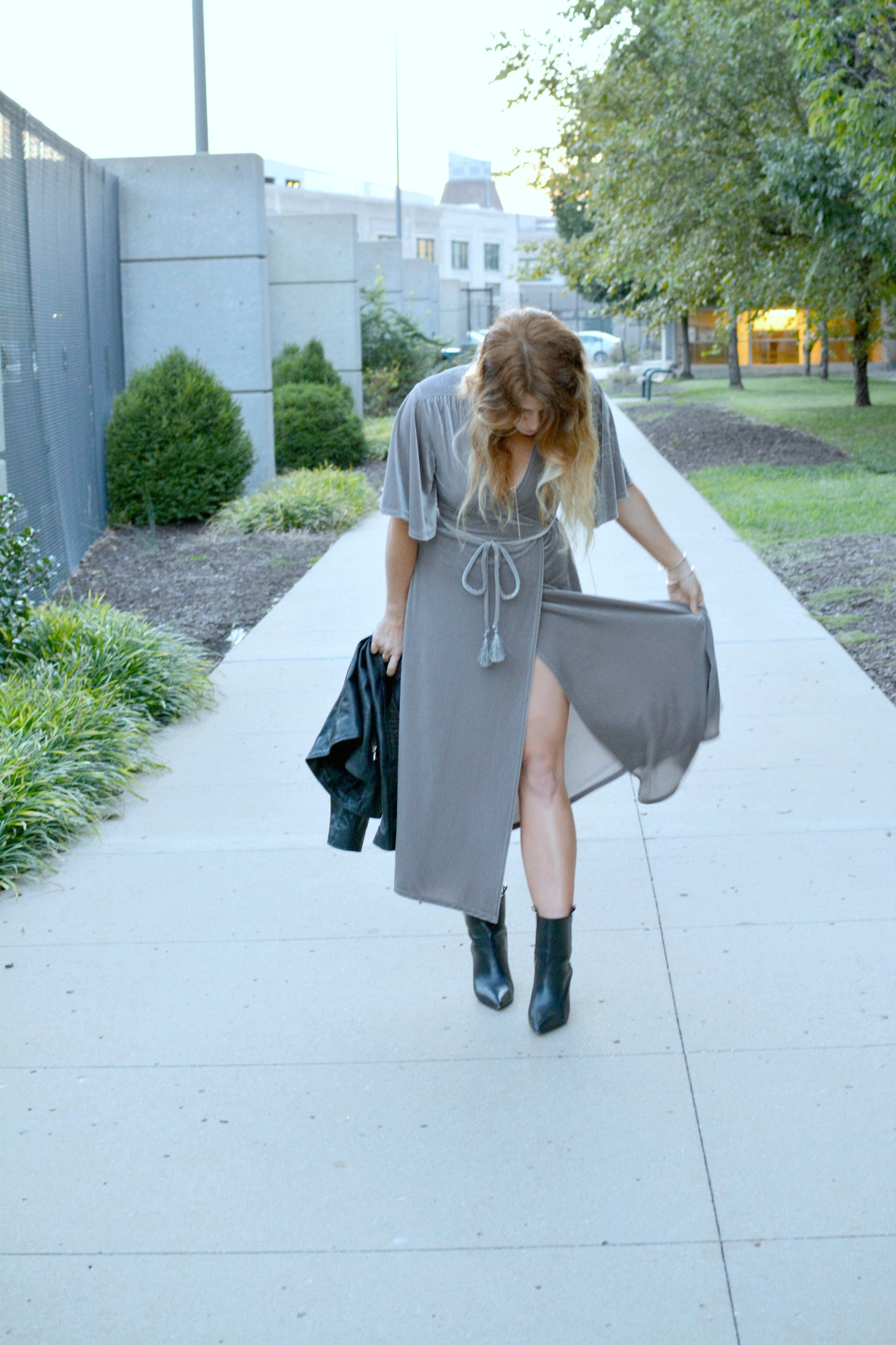 Ashley from LSR in a gray velvet dress and black leather boots