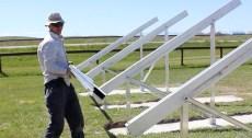 Scott Osborne of Rite Line Electric insalling solar panels on the Piikani Nation reserve