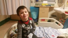 Tristen Smith smiles through his 2 week stay at the Alberta Children's Hospital.