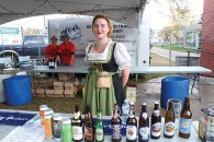 Bailey Parker serves traditional German beer at Oktoberfest on Friday, Sept 8.