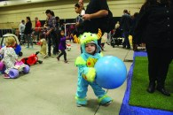 Mason Wafer bounces a ball at the Boo Bash held at the Exhibition Pavilion Oct. 29.