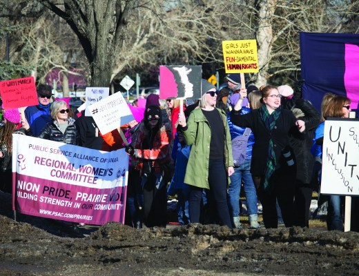 Supporters standing in solidarity for the Women's March on Washington along Mayor Magrath Dr. on Jan 21.