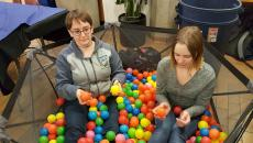 Tara Ludman (left) and Courtney Allred (right) recruit for the LGBTQ+ club in a ball pit at a booth in centre core. Ludman is the president of the LGBTQ+ club and is excited for the upcoming year.