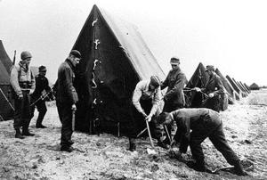 German POWs Erect Tents At Camp Tophat