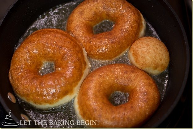 Super soft, adorned with crispy sugar glaze these doughnuts were a huge hit in our family! by LetTheBakingBeginBlog.com
